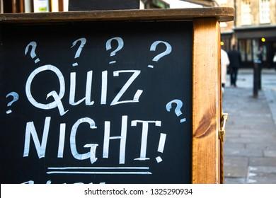 """London / United Kingdom - 1.20.2019: A writing on sandwich board outside a pub saying """"Pub Quiz"""""""