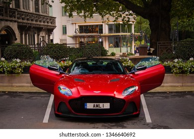 London, United Kingdom - 12/09/2018: A brand new Aston Martin DBS Superleggera parking at the Dorchester hotel with its doors open, near Hyde Park, in Mayfair, London.