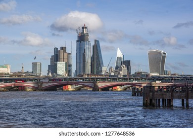 London, United Kingdom - 13 Nov, 2018 - Landscape view of Southwark Bridge on the river Thames and business modern district with many skyscrapers in the background. London, United Kingdom.