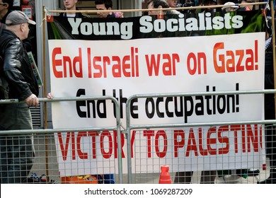 London, United Kingdom, 14th April 2018:- Protesters gather along Kensington High Street, near the Israeli Embassy in London to protest the ongoing occupation of Palestine.