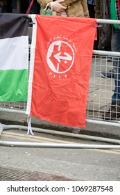 London, United Kingdom, 14th April 2018:- The flag of the PFLP at a gathering of protesters along Kensington High Street, near the Israeli Embassy in London to protest the occupation of Palestine
