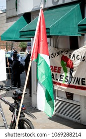London, United Kingdom, 14th April 2018:- The flag of Palestine at a gathering of protesters along Kensington High Street, near the Israeli Embassy in London to protest the occupation of Palestine.