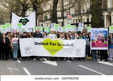 London, United Kingdom, 14th April 2018:- Marchers on a silent march from Kensington Town Hall to the ruins of Grenfell tower ten months on from the devastating fire that killed 71