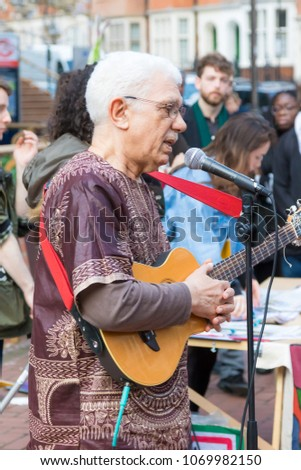 London, United Kingdom, 14th April 2018:- Performers before a silent march from Kensington Town Hall to the ruins of Grenfell tower ten months on from the devastating fire that killed 71