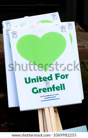 London, United Kingdom, 14th April 2018:- Banners ready for a silent march from Kensington Town Hall to the ruins of Grenfell tower ten months on from the devastating fire that killed 71