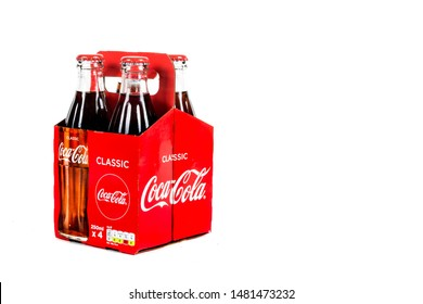 London, United Kingdom, 16th August 2019:- A pack of 4 Coca-Cola glass bottles. Contains 10.6g of sugar per 100ml