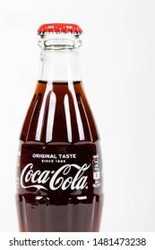 London, United Kingdom, 16th August 2019:- A Coca-Cola glass bottle. Contains 10.6g of sugar per 100ml