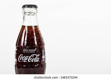 London, United Kingdom, 16th August 2019:- A cold Coca-Cola zero glass bottle. Coke Zero is sweetened with Aspartame.