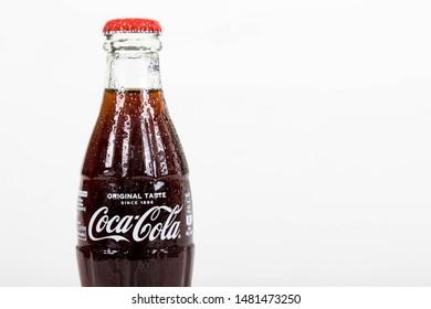London, United Kingdom, 16th August 2019:- A cold Coca-Cola glass bottle. Contains 10.6g of sugar per 100ml