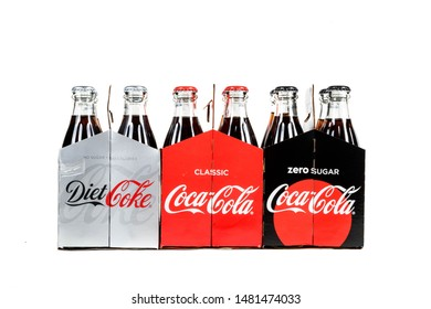 London, United Kingdom, 16th August 2019:- Glass bottles of Diet Coke, Coca-Cola Classic and Coke Zero. Coke Zero and Diet Coke are sweetened with Aspartame, Coca-Cola Classic is sweetened with Sugar.