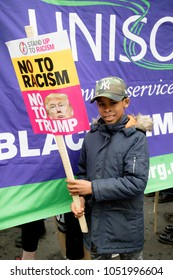 London, United Kingdom, 17th March 2018:- A young protester at the Stand Up to Racism march through central London from the BBC to outside Downing Street
