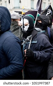 London, United Kingdom, 17th March 2018:- Masked protesters at The Stand Up to Racism march through central London