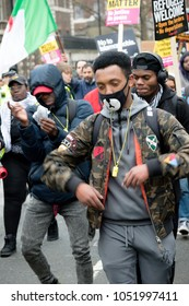 London, United Kingdom, 17th March 2018:- Protesters dance during the Stand Up to Racism march through central London