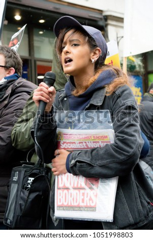 London, United Kingdom, 17th March 2018:- A speaker at the Stand Up to Racism march through central London