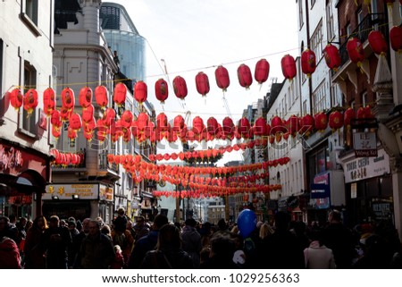 London, United Kingdom, 18th Febuary 2018:- Crowds enjoying the festivities to celebrate Chinese New Year in London's Chinatown area and surrounding streets, for the year of the dog 2018