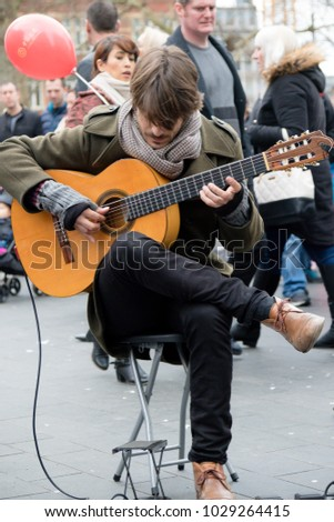 London, United Kingdom, 18th Febuary 2018:- A street perfomer perfoming as part of the festivities to celebrate Chinese New Year in London's Chinatown area, for the year of the dog 2018