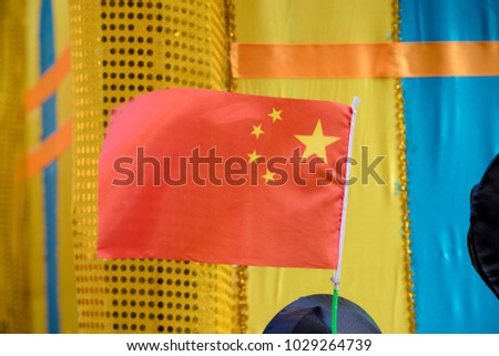 London, United Kingdom, 18th Febuary 2018:- The People's Repbulic of China's flag flys at festivities to celebrate Chinese New Year in London's Chinatown area, for the year of the dog 2018