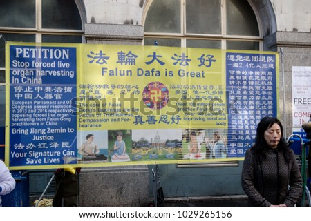 London, United Kingdom, 18th Febuary 2018:- Falun Gong members protesting during festivities to celebrate Chinese New Year in London's Chinatown area, for the year of the dog 2018