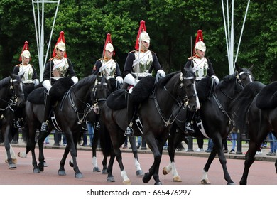 London, United Kingdom - 19 May 2017: The mounted royal horse guards from the Blues and Royals regiment, parading pass The Mall in front of Buckingham Palace