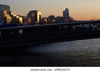 London / United Kingdom - 20 05 2018: view at the skyline in the evening sun at the tower millennium pier