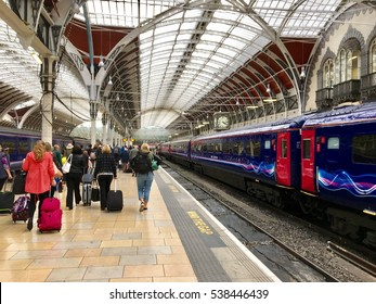 "London, United Kingdom - 20th September 2016:Conceptual image of Train and Commuters on platform of ""London Paddington"" railway station, London, UK"
