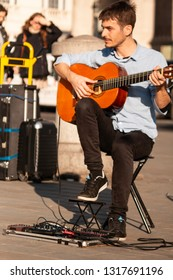 London / United Kingdom - 2.15.2019: A handsome male guitar player busking at the Trafalgar Square