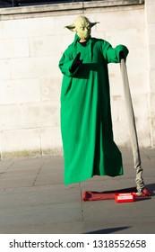London / United Kingdom - 2.15.2019: A street entertainer impersonating a levitating Yoda in Trafalgar Square