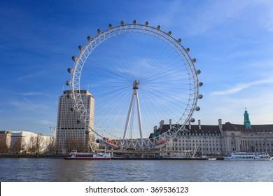 LONDON, UNITED KINGDOM â?? 22 JANUARY 2016: London Eye is the tallest Ferris wheel in Europe at 135 meters and Country Hall in London, United Kingdom