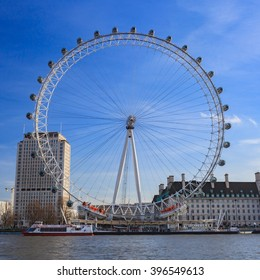 LONDON, UNITED KINGDOM - 22 JANUARY 2016: London Eye is the tallest Ferris wheel in Europe at 135 meters and Country Hall in London, United Kingdom