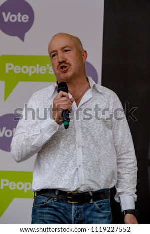 London, United Kingdom, 23rd June 2018:- Comedian Andy Parsons hosts the March for a People's Vote in Central London demanding a vote on the final deal on Britain's exit from the EU