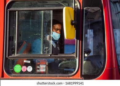 London, United Kingdom.  23rd March 2020.  A bus driver is seen wearing a face mask as the UK adjusts to life under the Coronavirus pandemic Credit: Michael Tubi/Alamy Live News.