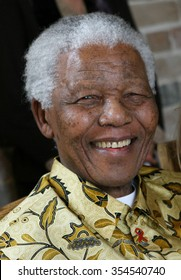 LONDON, UNITED KINGDOM- 24 MAY 2006: Late South African president Nelson Mandela smiles as he poses for a portrait in London.