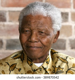 LONDON, UNITED KINGDOM- 24 MAY 2006: Late South African president Nelson Mandela looks on as he poses for a portrait during an event in London.