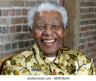 LONDON, UNITED KINGDOM- 24 MAY 2006: Late South African president Nelson Mandela smiles as he poses for a portrait during an event in London.
