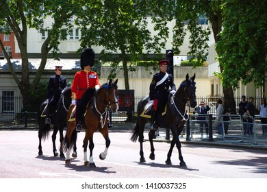 LONDON, UNITED KINGDOM -  25th June 2019: Horsemen and palace guard in front of the Buckingham palace. Queen's birthday celebration rehearsal.