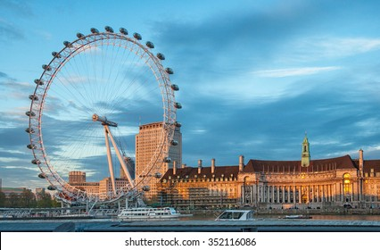 LONDON, UNITED KINGDOM - 26 APRIL,2015: The London Eye on the South Bank of the River Thames at sunset n London, England on 26 April 2015.