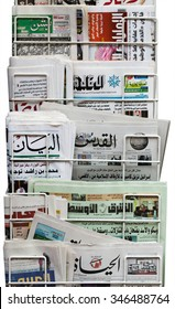 LONDON, UNITED KINGDOM 27 OCTOBER 2015: An international newspaper rack holding several middle eastern and British arabic newspapers, including Asharq Al-Awsat, Al-Hayat, Al Quds Al Arabi and Al-Arab.