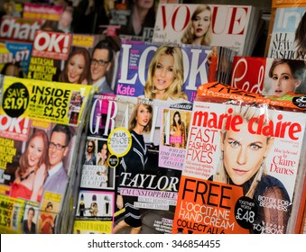 LONDON, UNITED KINGDOM 27 OCTOBER 2015: Newsstand found in central London displaying many international Women's and gossip titles such as Marie Claire, OK, Look, Red, Vogue UK, Grazia and Chat