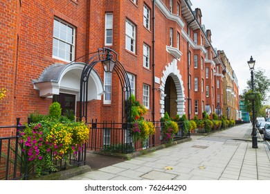 London, United Kingdom - 29 October 2017: Regency street, cityscape of London, ordinary houses made of red bricks stand in a row
