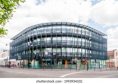 London, United Kingdom, 5 June, 2021: Hyderabadi bawarchi Indian restaurant and new apartment in East Ham Centre Ron Leighton Way, East Ham, Newham, London, United Kingdom