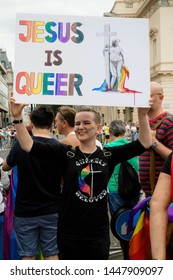 London, United Kingdom, 6th July 2019:- Participant in London Pride 2019 holding a sign reading jesus is Queer