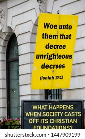 London, United Kingdom, 6th July 2019:- Christian protesters at London Pride 2019 holding signs quoting the bible