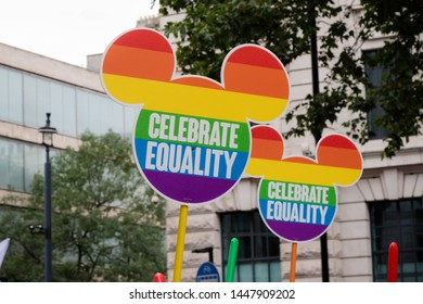 London, United Kingdom, 6th July 2019:- Micky Mouse shaped pride signs reading Celebrate Diviersity at the London Pride Parade 2019