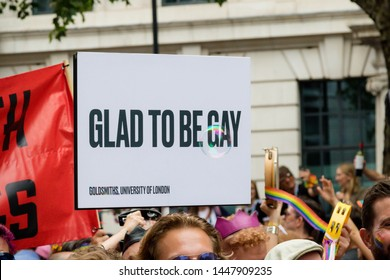 London, United Kingdom, 6th July 2019:- A sign reading Glad to Be Gay at London Pride 2019