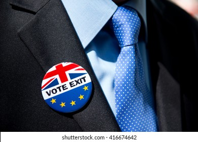 London, United Kingdom. 6th May 2016. EDITORIAL - Businessman in a dark business suit, wearing a VOTE EXIT pin badge, for the fourth coming E.U. referendum election on 23rd May 2016.