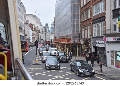 LONDON, UNITED KINGDOM, 8 APRIL 2018 - Traffic is rushing through the streets of London City just before dawn.