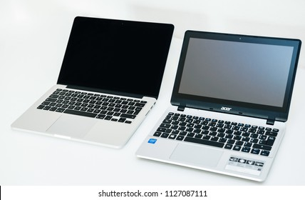 LONDON, UNITED KINGDOM - Apple Mac Book pro and Acer Aspire laptop notebook next to eachoterh on white table