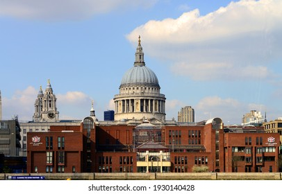 LONDON, UNITED KINGDOM - Apr 07, 2015: Famous City of London School, on edge of River Thames, London, United Kingdom, with dome of St Paul's Cathedral, behind it, in background
