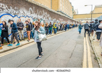 London, United Kingdom - April 09, 2016: The London Coffee Festival (07-10 April, Brick Lane, Old Truman Brewery). A very long queue for entrance to the festival