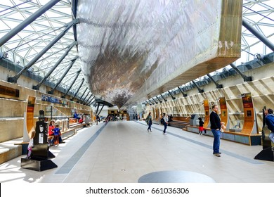 LONDON, UNITED KINGDOM - APRIL 10, 2017: Tourists at the exhibition underneath Cutty Sark's keel. Cutty Sark was preserved as a museum ship and become a popular tourist attraction in Greenwich.